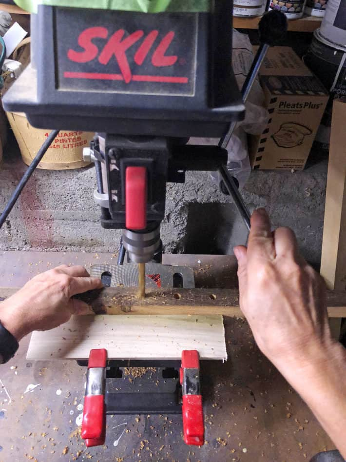 Lowering the handle on a drill press.