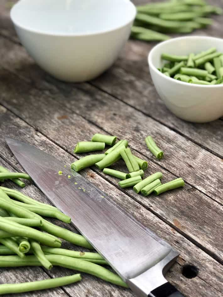 Fresh green beans cut into 1 inch lengths.