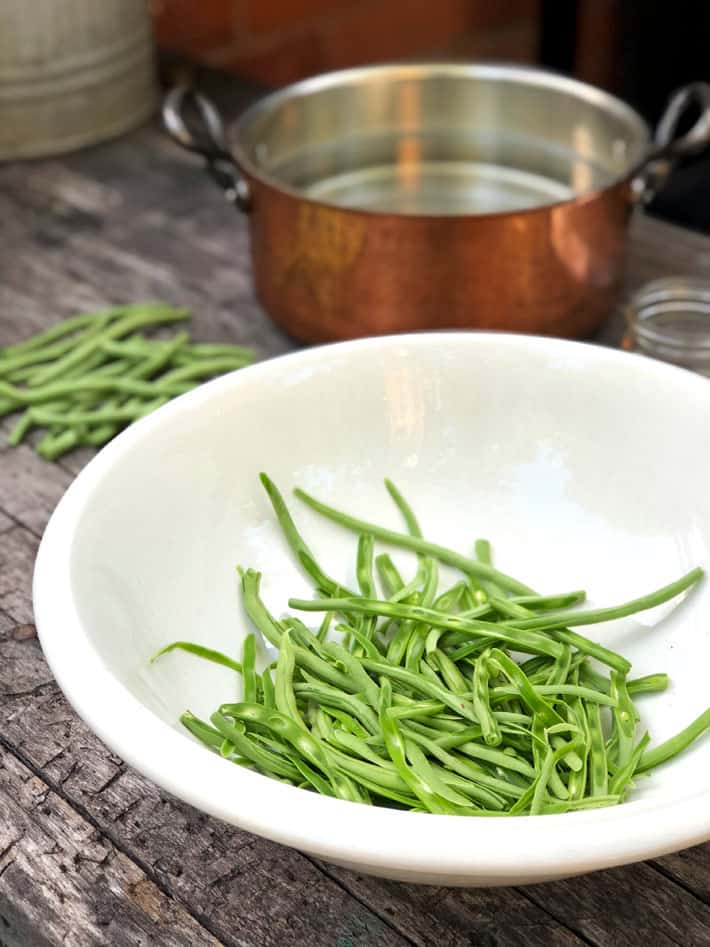 Frenched filleted green beans in an antique ironstone bowl.