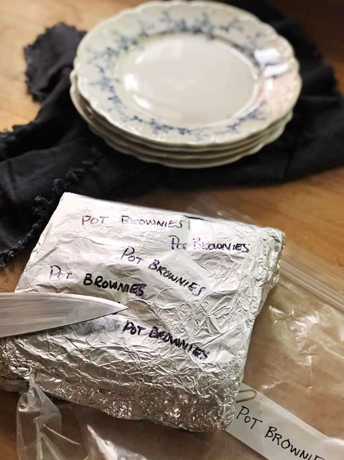 Pot brownies wrapped in a double layer of foil and a plastic bag for well identified freezer storage.