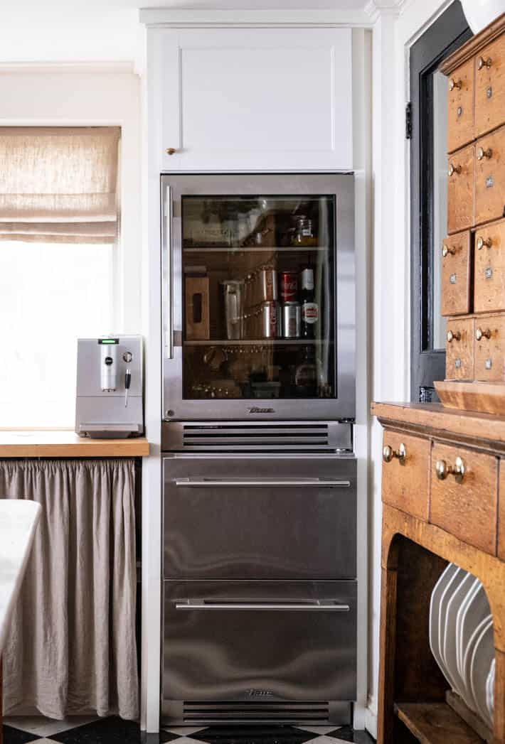 Restaurant style glass door refrigerator by True Residential, in a country kitchen.