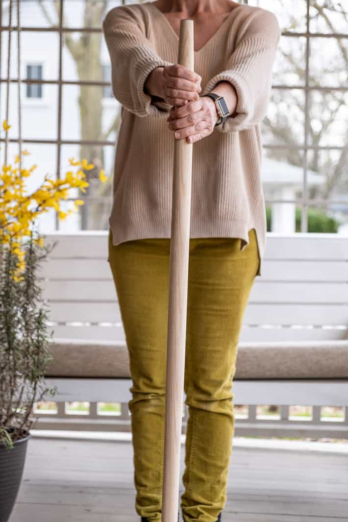 Karen Bertelsen (wearing chartreuse pants) holding a brand new shovel handle.