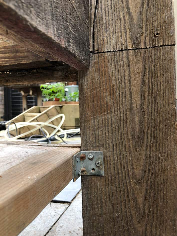 Corner section of The Art of Doing Stuff's Restoration Hardware outdoor sectional featuring L brackets to join seat.