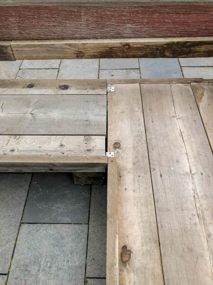 Building the corner of an outdoor sectional using L brackets.