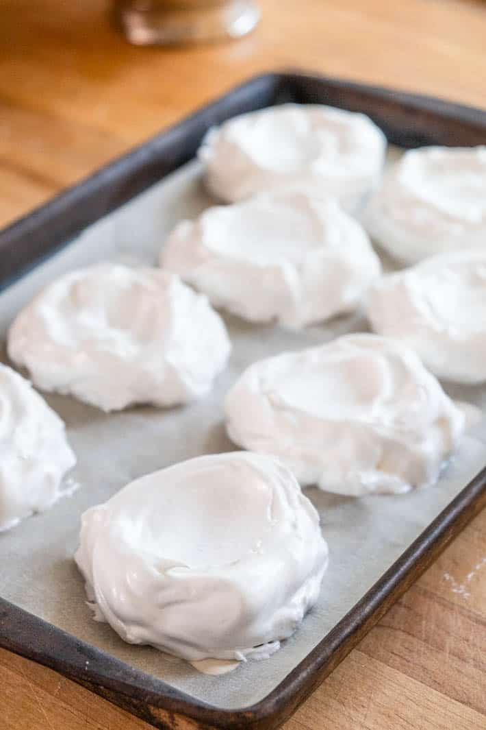 Meringues on baking tray ready to go in oven.