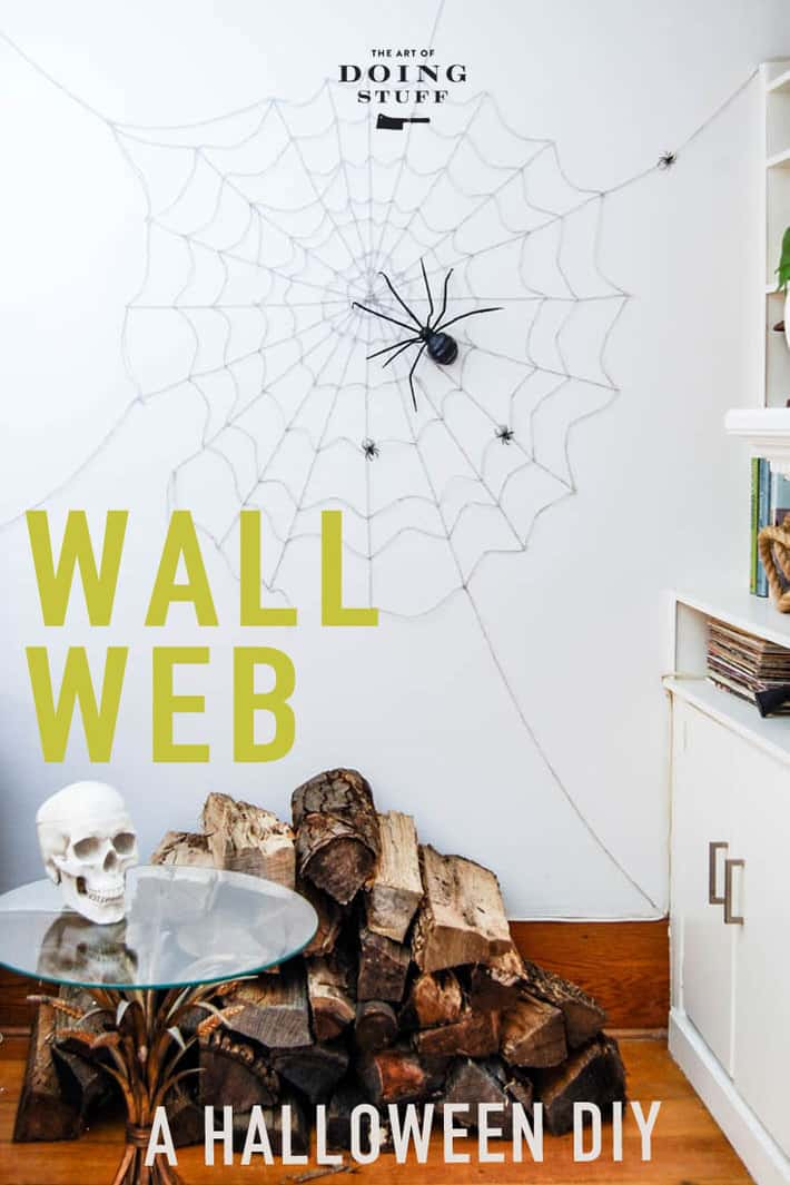Make a MASSIVE wall spider web for your Halloween party. Or you know, just for yourself because you\'re cool like that - a Halloweenie. All you need is string, two way tape and a spider.