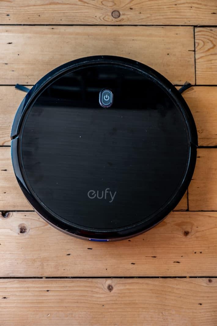 Eufy 11s automatic vacuum on hardwood floors.