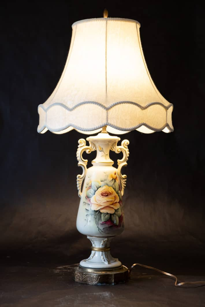 Vintage ornate painted lamp with original shade and new wiring.