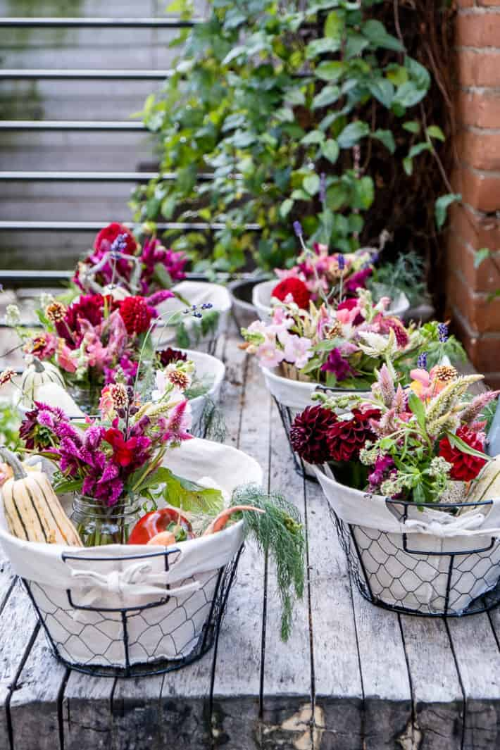 Take home Thanksgiving dinner baskets filled with flowers and late season harvests like squash and carrots.