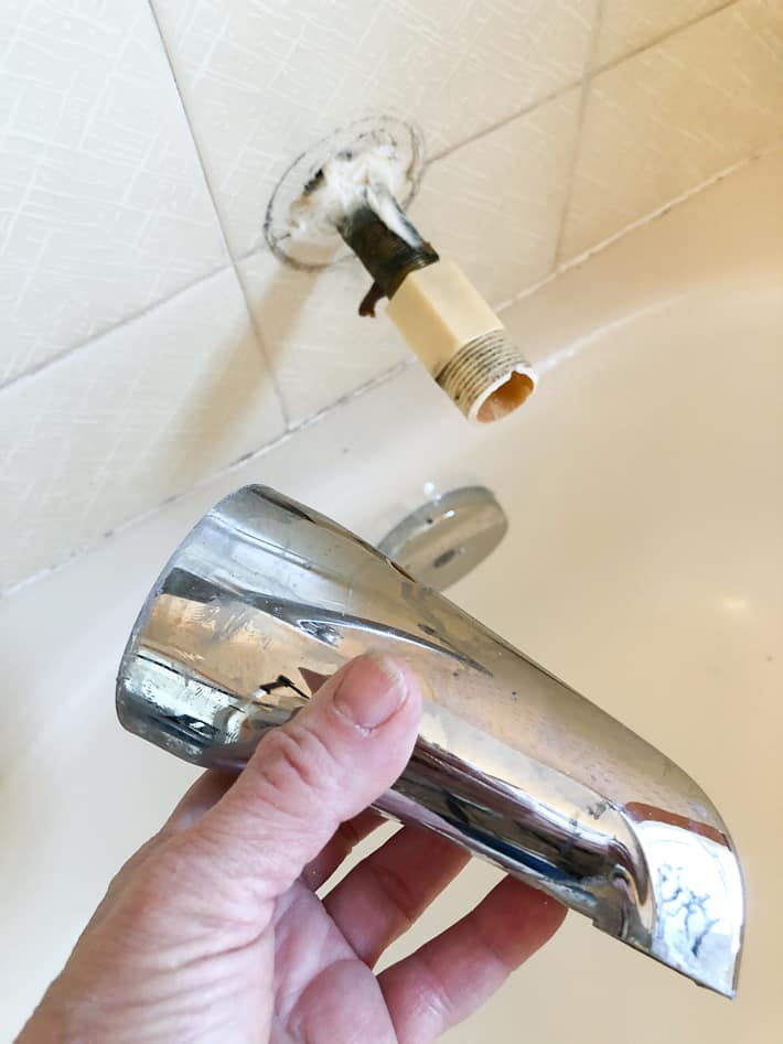 An old tub faucet removed by unscrewing it.