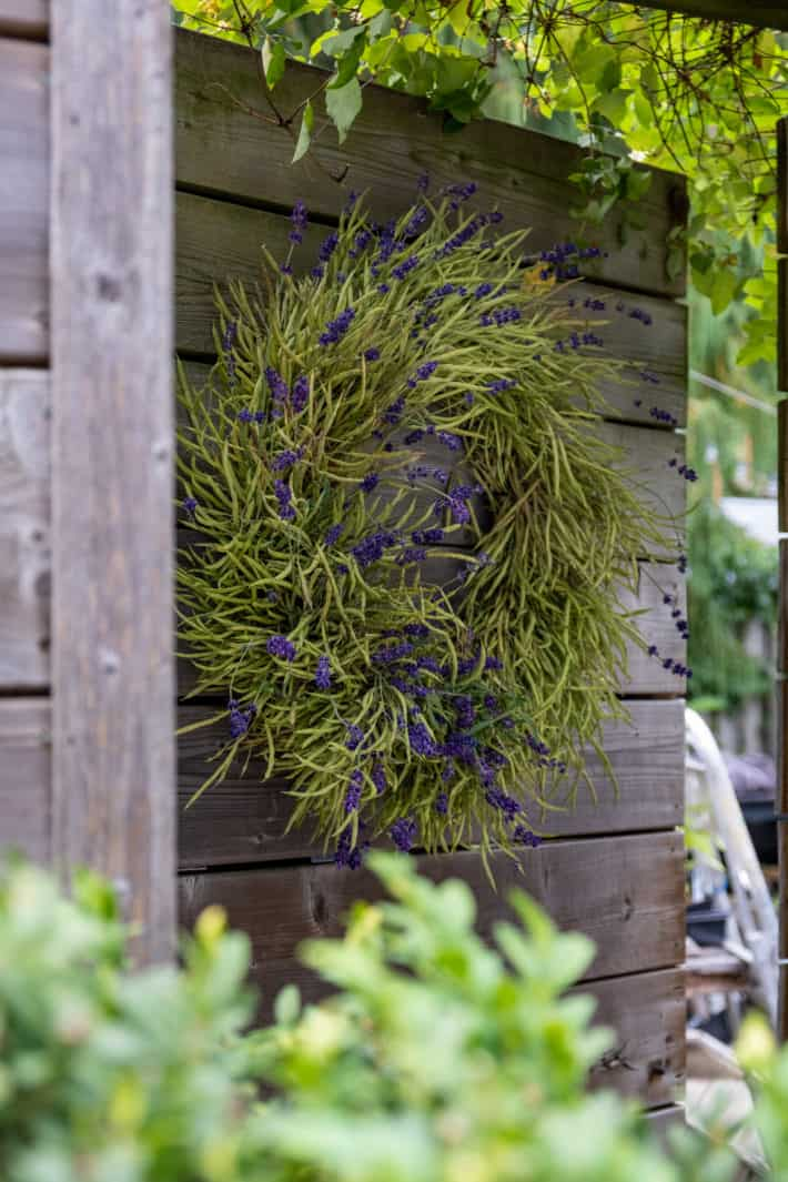 A DIY wreath made of kale seed pods and sprigs of lavender.