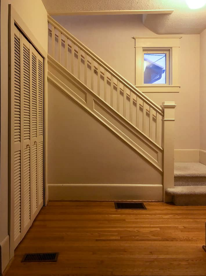 All beige staircase from 1920 including spindles and newel post.