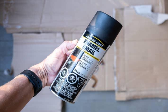 Can of black enamel spray paint.