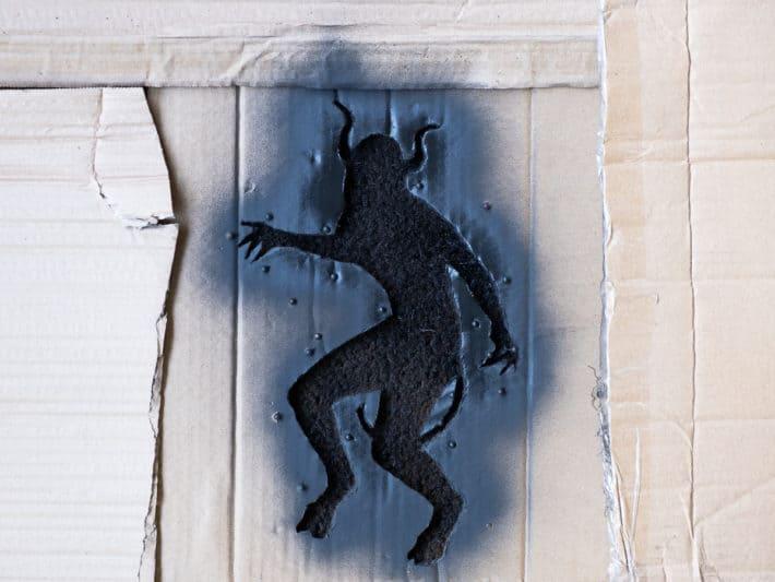 First coat of spray paint on DIY doormat.