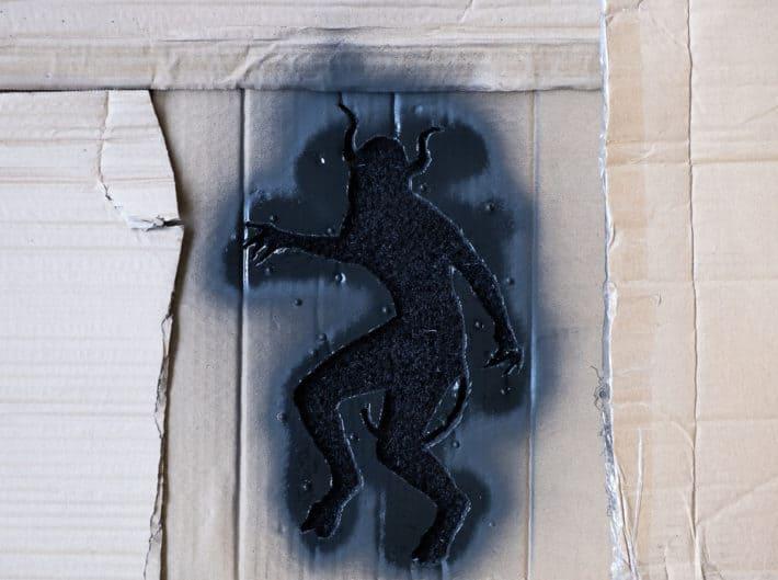 Second coat of paint on DIY doormat.