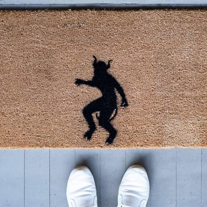 DIY demon Halloween doormat seen from above with 2 feet.