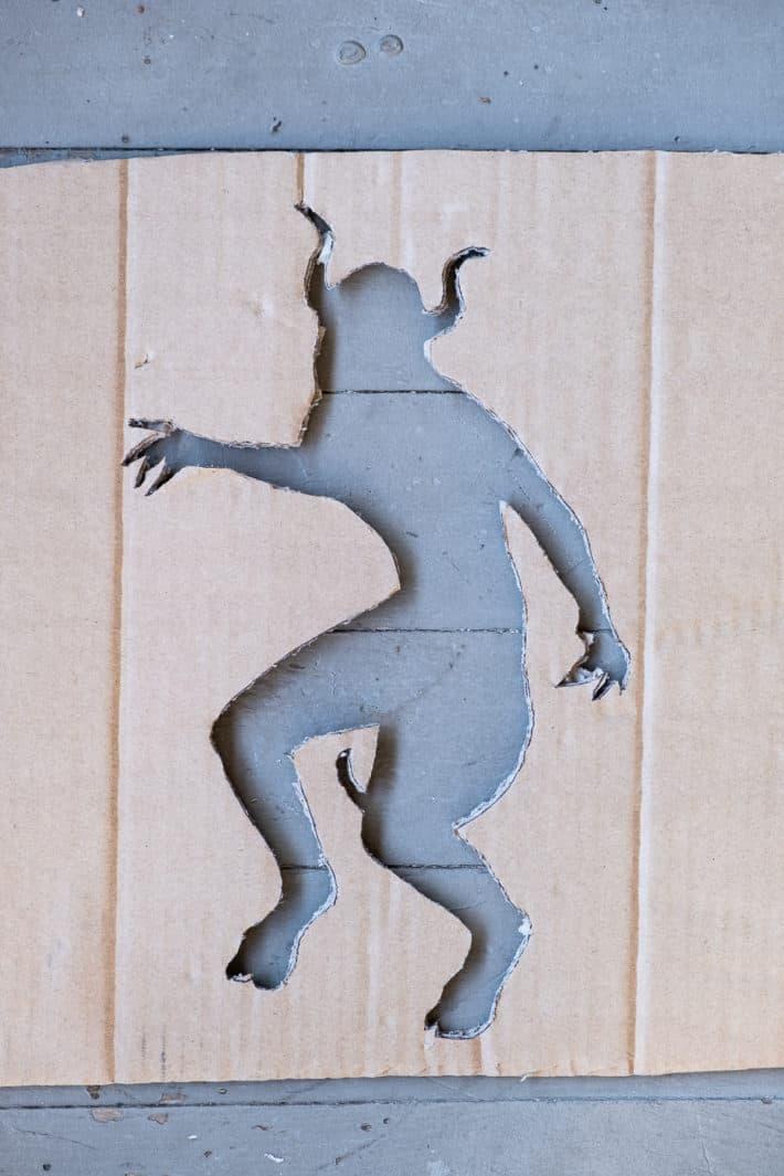 Stencil of demon made of cardboard.